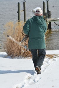 COM on his way to the dock with the camera and new high tech protective camera gear.  What's that white stuff on our lawn and dock?