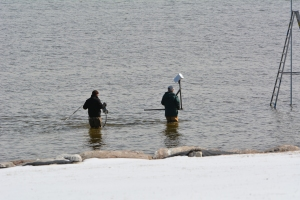 Wading out to the pole with the camera.  Brrr!